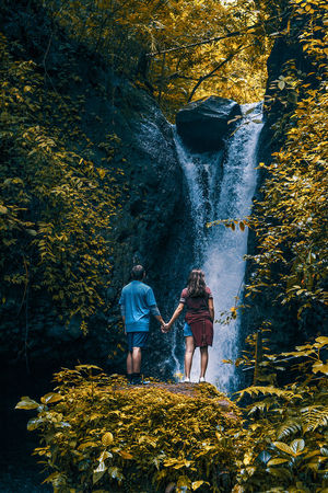 tilaran Beauty In Nature Couple - Relationship Day Lifestyles Men Nature Outdoors Plant Real People Rock Solid Standing Togetherness Two People Water Waterfall Women Summer Exploratorium