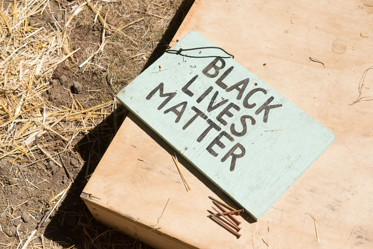 Black Lives Matter Sign America Belief Black Lives Matter Close-up Communication Community Construction Day Festival Festival Season Hand Painted Important No People Outdoors Peace Peaceful Protest Production Protest Sign Sign Of The Times Small Town America Small Town Stories Sunny Text Wooden Sign