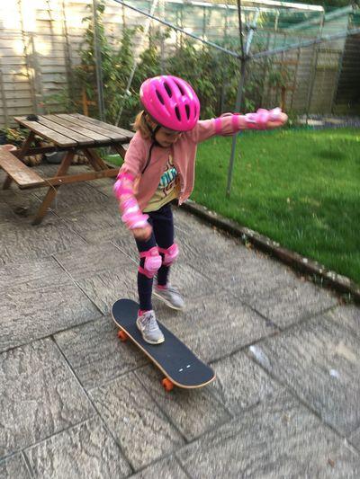 Full length of woman skateboarding on skateboard