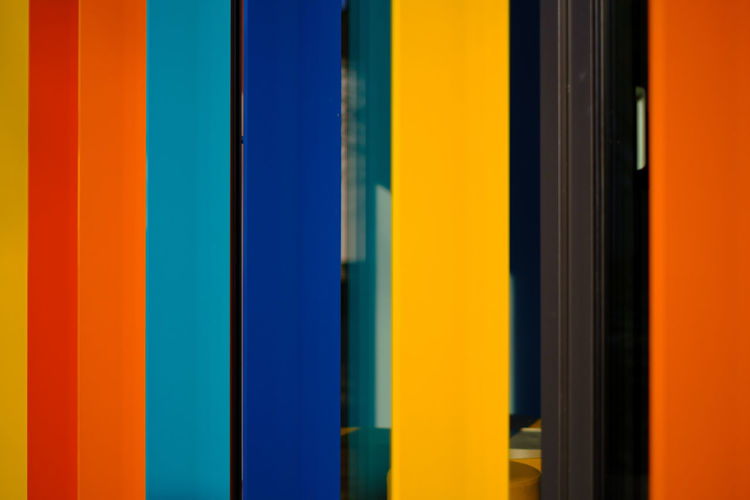 VERTICAL No People Yellow Close-up Architecture Built Structure Window Day Full Frame Multi Colored Backgrounds Blue Pattern Variation Choice Indoors  Striped Wall - Building Feature Orange Color Vibrant Color Side By Side
