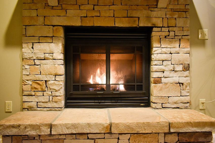 Stoney fireplace Architecture Built Structure No People Wall - Building Feature Building Wall Fireplace Brick Stone Wall Illuminated Modern Hospitality
