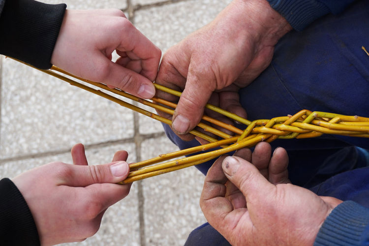High angle view of people holding sticks outdoors