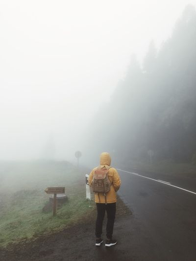 Autumn Travel Adventure Outdoors Fog Real People Winter Nature Rear View Standing Lifestyles Cold Temperature Leisure Activity One Person Day Casual Clothing Beauty In Nature Outdoors Warm Clothing Autumn Mood