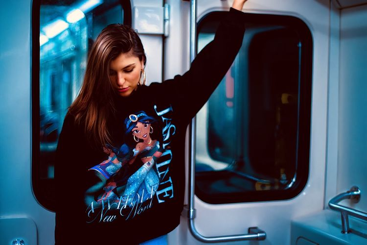 Young Woman Standing In Train