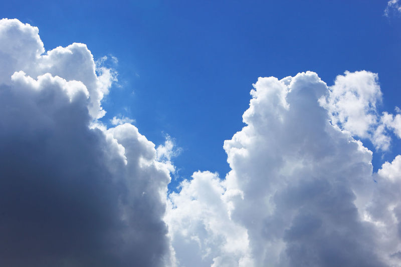 clouds in the sky, rain clouds, low pressure area Backgrounds Beauty In Nature Blue Cloud - Sky Cloudscape Day Fluffy Full Frame Idyllic Low Angle View Meteorology Nature No People Outdoors Rain Clouds Scenics - Nature Sky Softness Sunlight Tranquil Scene Tranquility White Color