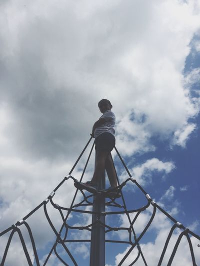 Low angle view of person standing against sky