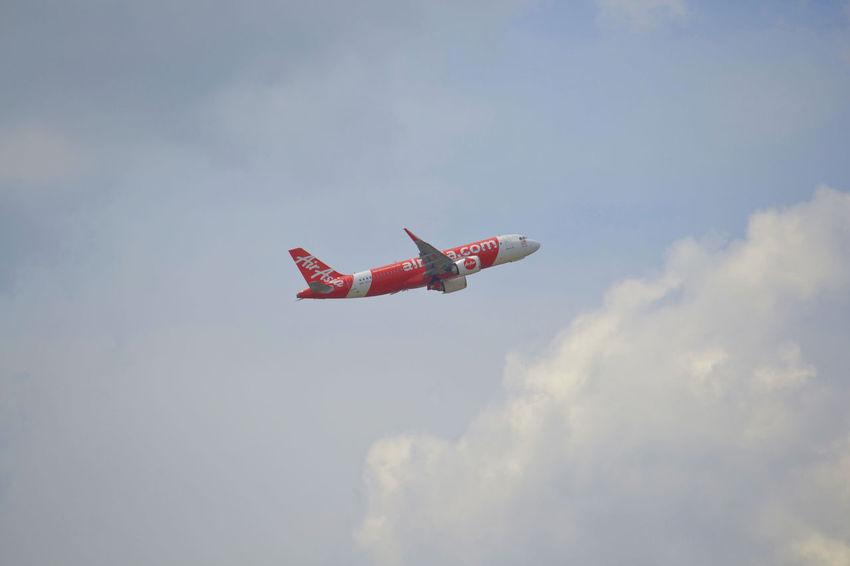 Air Asia Air Asia Flying Airshow Airplane Sky Mid-air Transportation Aerobatics Cloud - Sky