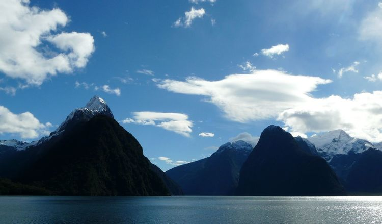 Beauty In Nature Blue Blue Sky And Clouds Cloud Cloud - Sky Cloudy Day Idyllic Majestic Milford Sound Mitre Peak Mountain Mountain Range Nature New Zealand Scenery Non-urban Scene Outdoors Scenics Serene Tranquil Outdoors Sky Snowcapped Mountain Tranquil Scene Tranquility Water