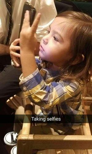 Grandson Jaxx taking selfies at his grandmas wedding