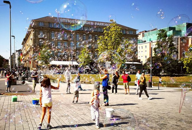 The City Light soap bubbles Large Group Of People Tree People Outdoors Sky Day Adult Düsseldorf Steigenberger Hotel Soapbubbles Kids Playing Kids Having Fun Sunny Day Joy Of Life City Life Escape Germany🇩🇪