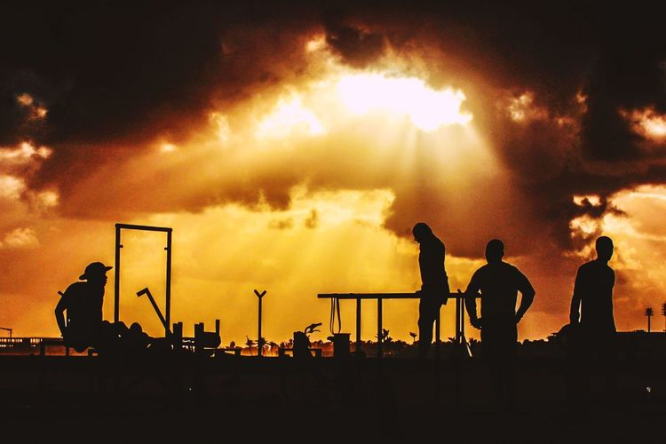 Workout💪🔥 Silhouette Group Of People Sky Real People Men Orange Color Cloud - Sky Sunset Standing Nature People Lifestyles Adult Occupation Arts Culture And Entertainment Crowd