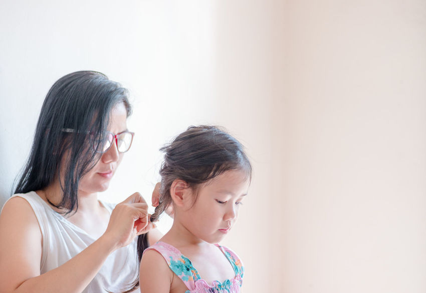 Adult Bonding Casual Clothing Child Childhood Day Eyeglasses  Family With One Child Girls Hair Stylist Hairstyle Headshot Indoors  Leisure Activity Lifestyles Mother And Daughter People Real People Togetherness Young Adult Relaxed Parenting