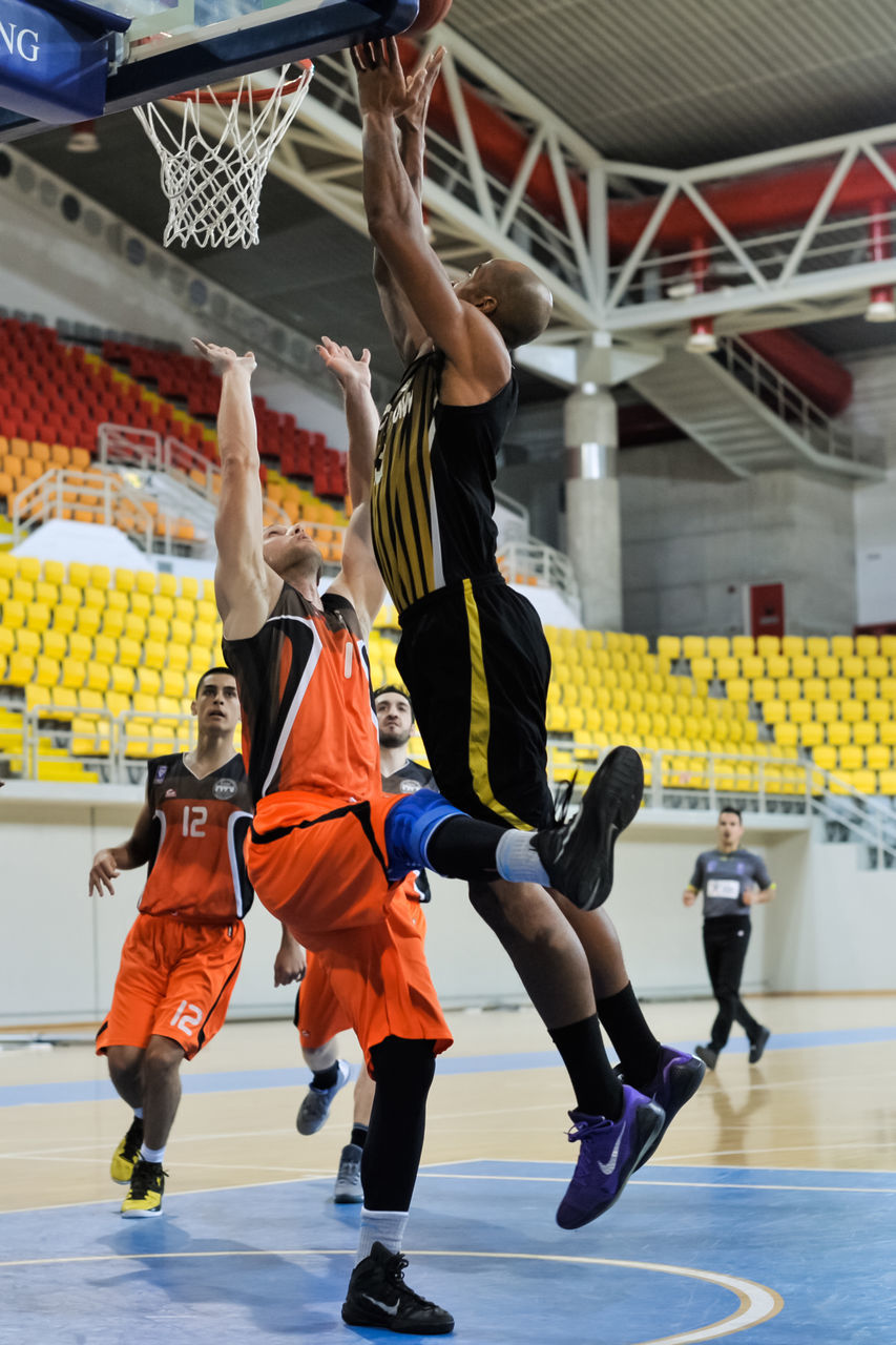basketball - sport, sport, competition, playing, real people, sports uniform, leisure activity, competitive sport, basketball player, indoors, full length, scoring, men, court, stadium, day, athlete, sportsman, sports team, people