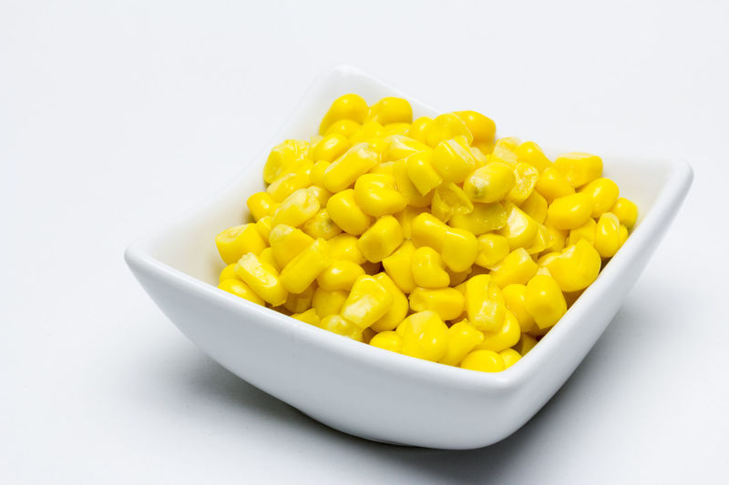 delicious canned sweet corn Cereal, Vegetable, Grain, Seeds, Corn, Corn, Sweet, Tender, Juicy, Tasty, Healthy, Ingredient, Preserved, Bowl, Cob, Steel, Canning. Packaging, Canned, Vegetarian, Vegan, Yellow, Isolated, White Background Bowl Close-up Corn Food Food And Drink Freshness Healthy Eating Indoors  No People Still Life Studio Shot Sweetcorn Vegetable Wellbeing White Background Yellow