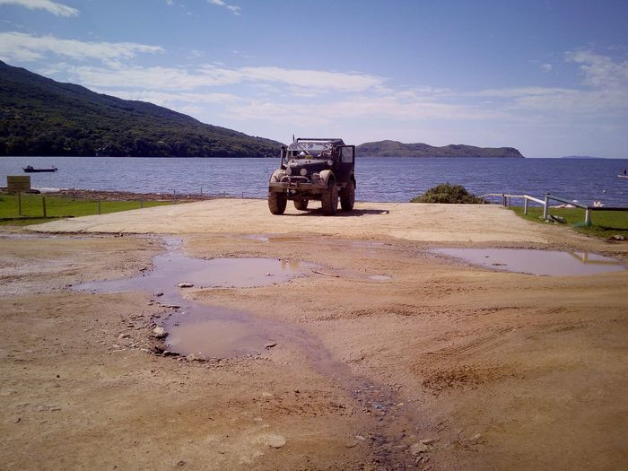 off-road vehicle Summer Water Off-road Vehicle Vehicle Road Old Auto Dirty Dirty Road Dirty Track Sky Non-urban Scene Sea EyeEm Selects Oil Pump Water Sand Dune Beach Sand Sky Country Road