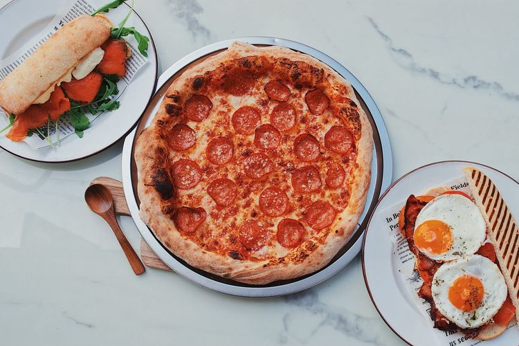 High angle view of pizza served on table