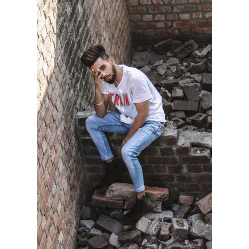 Young man leaning against wall