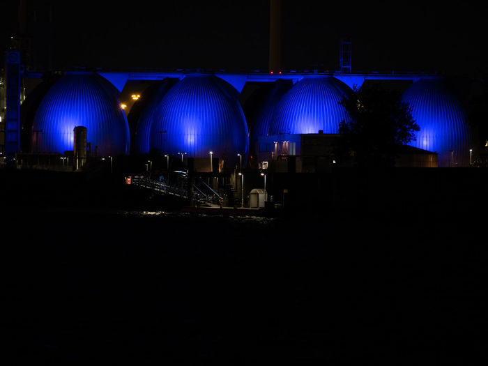 Illuminated lights against blue sky at night