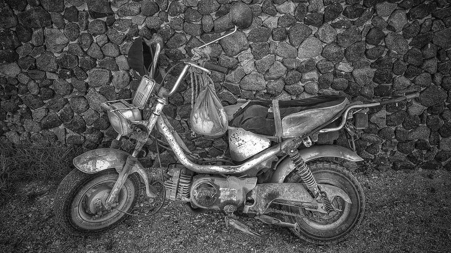 old scooter still working hard on the island of Santorini Malephotographerofthemonth Creative Light and Shadow Monochrome Blackandwhite Photography Scooterlife Black And White Photography Old Scooter Backgrounds Full Frame High Angle View Close-up Textured  Detail
