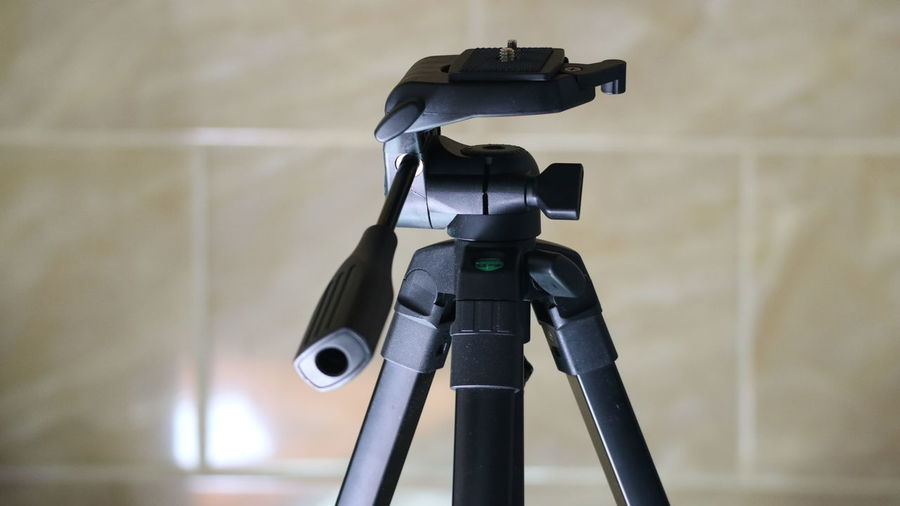 Close-up of tripod against wall