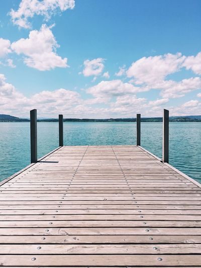 Lake view from wooden deck, Zug. Balance Beauty In Nature Blue Blue Sky Cloud Contrast Horizon Over Water Lake View Lake Zug Lakescape Landscape Shadow Summer Symmetrical Symmetry Water Wooden Deck