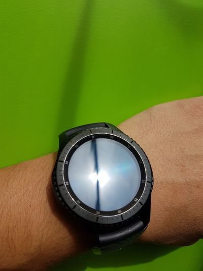Close-up of person wearing smart watch