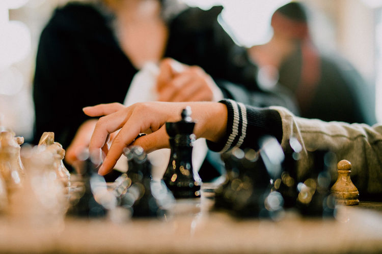 Cropped Image Of People Playing Chess