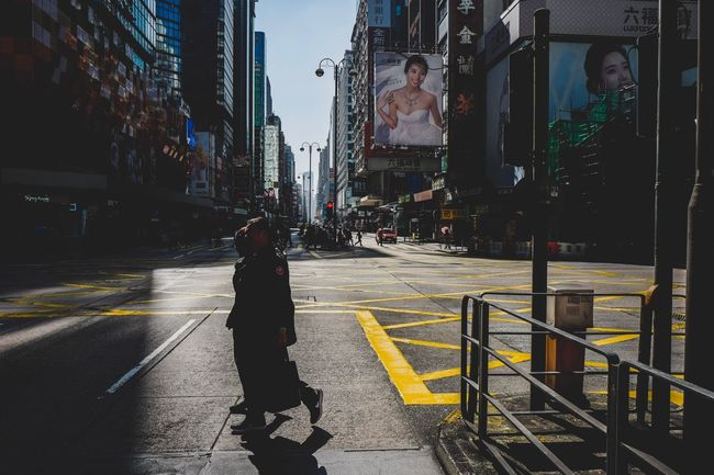 Shadow And Light Street Photography Reframinghk Discoverhongkong City Building Exterior Street Transportation Architecture Built Structure Road Mode Of Transportation One Person Car Motor Vehicle Lifestyles Sign Day Road Marking Walking Real People Nature City Street Land Vehicle