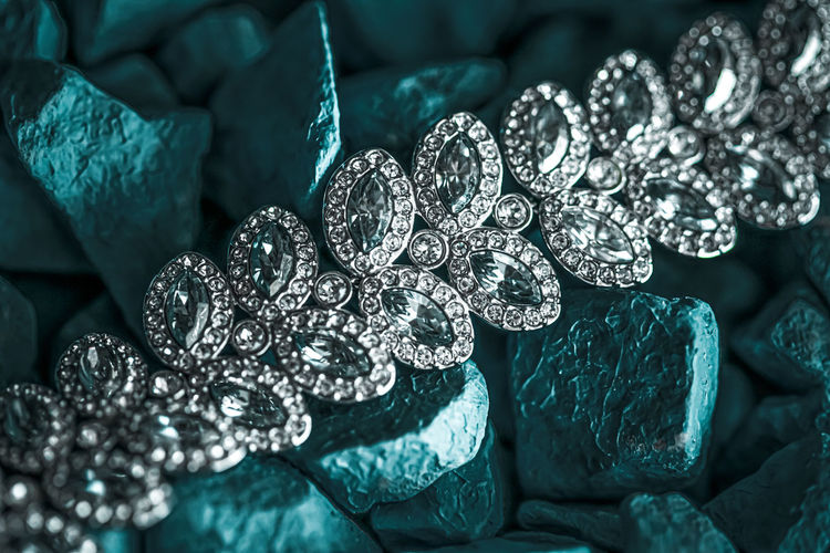 Full frame shot of jewelry on stones outdoors
