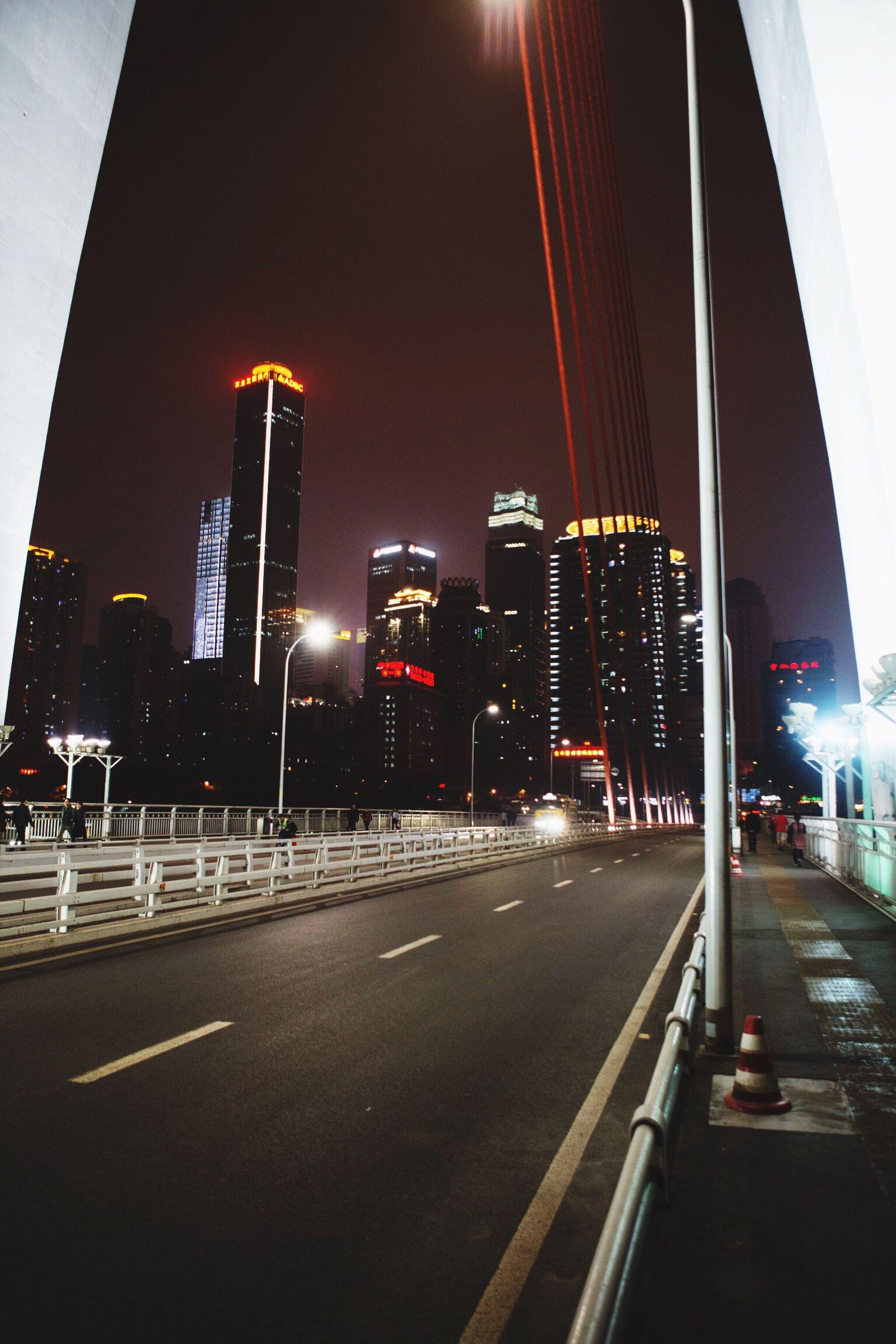 architecture, city, built structure, building exterior, transportation, illuminated, road, outdoors, car, night, modern, no people, skyscraper, urban skyline, sky