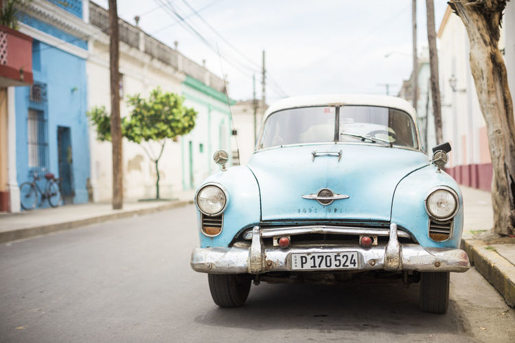 Architecture Auto Bike Blue Built Structure Car Cars Cuba Day Land Vehicle Low Angle Low Angle View Mode Of Transport No People Old Car Oldtimer Outdoors Shallow Sky Street Streetphotography Transportation Tree Vivid Vivid Colours