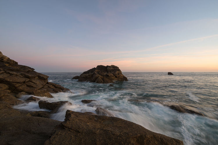 Sunrise on the rocky coast of Brittany, France, Finistere Rock Sea Water Sky Rock - Object Solid Beauty In Nature Motion Sunset Scenics - Nature Horizon Over Water Land Horizon Beach Nature Rock Formation No People Outdoors Finistere Bretagne Bretagnetourisme France Waves, Ocean, Nature Waves Crashing On Rocks Tide Ocean View Coastline