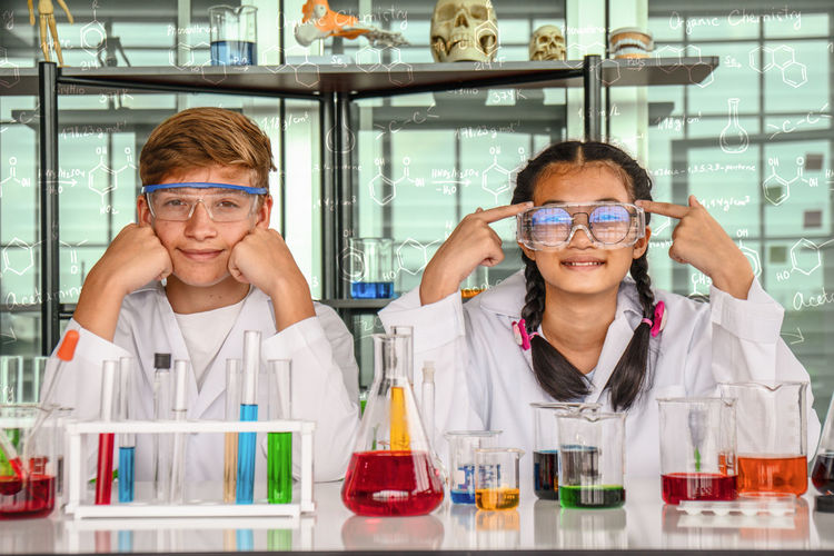 Portrait of confident students sitting in laboratory