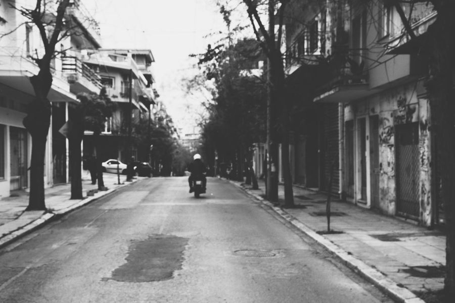 """""""The motorcycle diaries"""" EyeEm Gallery Eye4photography  Blackandwhite Photography Blackandwhite From My Point Of View The Week on EyeEm Malephotographerofthemonth Getting Inspired Street Streetphotography Motorcycle Road depth of field City Life Athens, Greece From Where I Stand Motor Vehicle Transportation Vehicle City Street The Way Forward City Built Structure Adult Outdoors People Day Building Exterior Tree"""