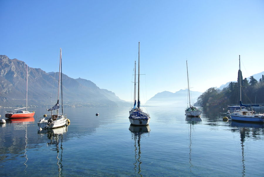 Day Outdoors Sky Perspectives On Nature Ship Lake View Lake Como Lake Italy Beauty In Nature Nofilter No People Small Harbour Mountains Boats Sun Como EyeEmNewHere
