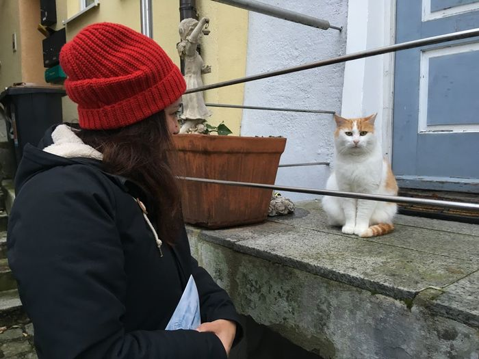 Mammal Domestic Real People Domestic Animals One Person Pets One Animal Hat Domestic Cat Vertebrate Cat Feline Lifestyles Women Clothing Sitting Warm Clothing Day Outdoors