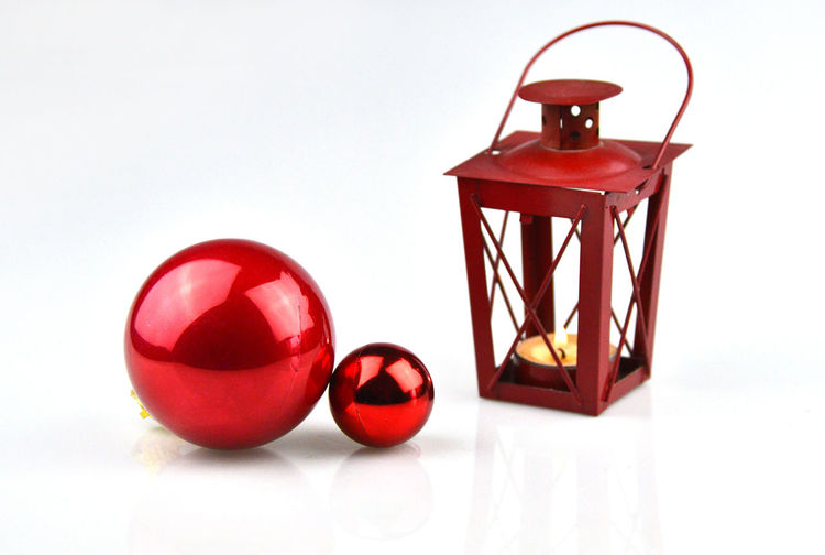 Close-up of red ball on table against wall
