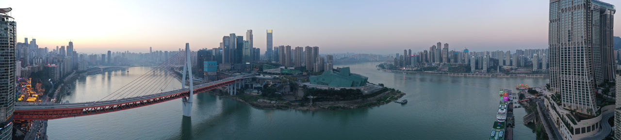 Panoramic view of buildings in city at waterfront