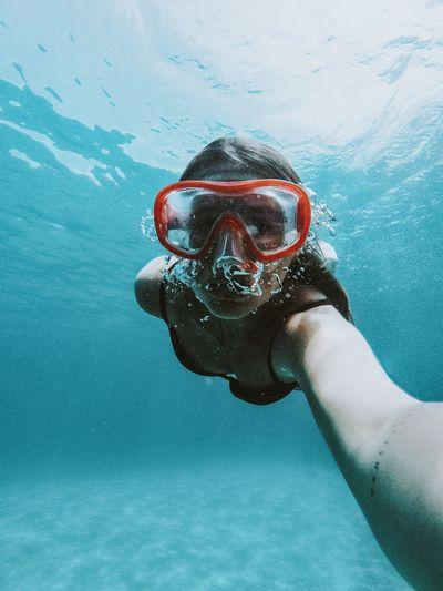 Portrait of woman swimming in sea