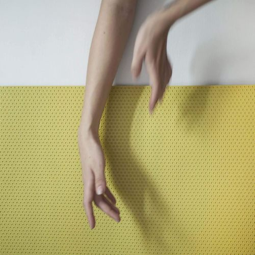 Cropped Hand Of Woman Over Table
