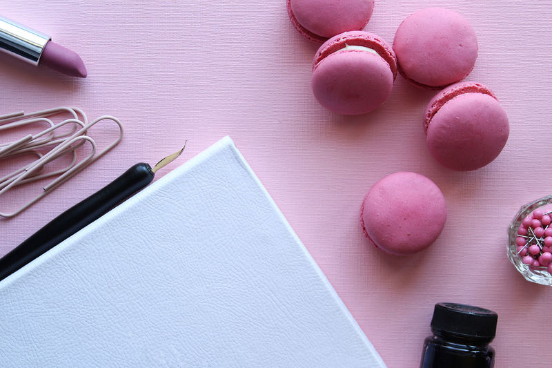 Office desk with macarons Calligraphy Cookies Copy Space Desk Desks From Above Dessert Desserts Elégance Feminine  Fun Macarons Office Pink Snack Working Close Up Concept Directly Above Food Ink Luxury Office Supplies Pen Push Pins Whimsical