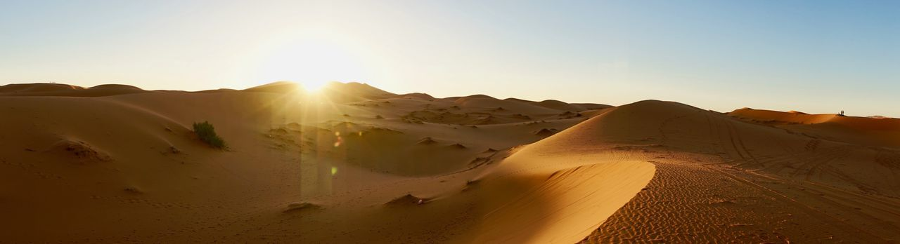 Sky Landscape Desert Sunlight Mountain Scenics - Nature Environment Beauty In Nature Nature Sand Dune Sun Land Clear Sky Tranquility Lens Flare Sand Tranquil Scene Travel Non-urban Scene Outdoors No People Arid Climate Climate