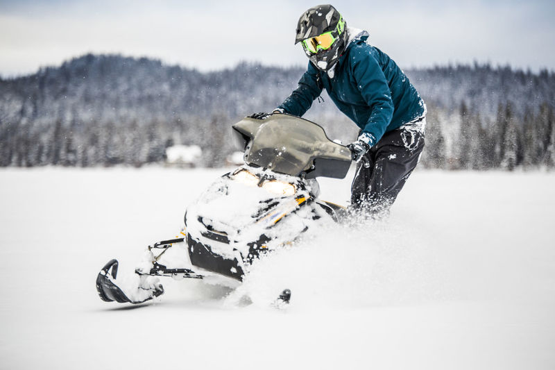 Person riding motorcycle on snow