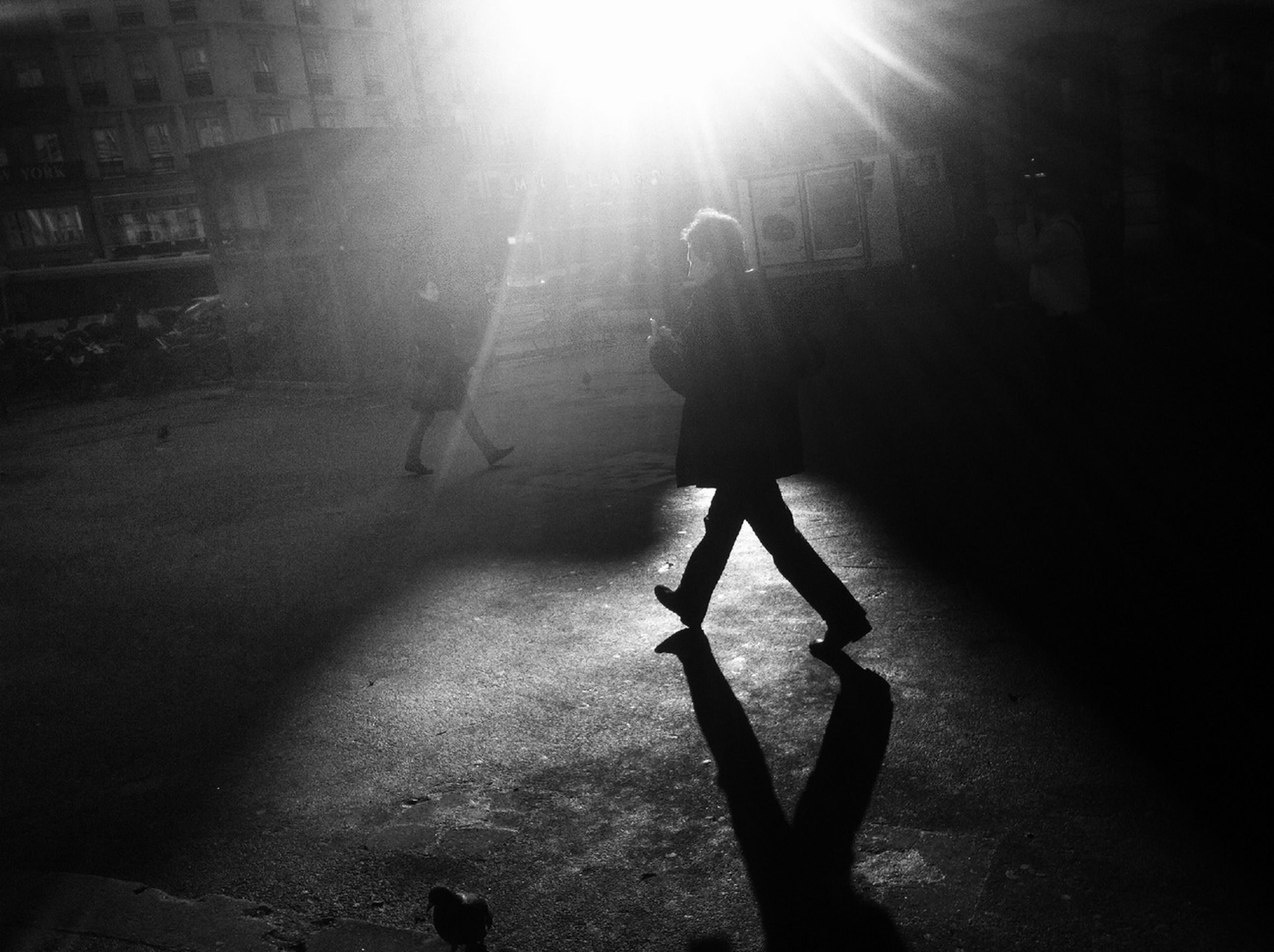 lifestyles, shadow, leisure activity, sunlight, silhouette, walking, men, sunbeam, full length, night, lens flare, standing, street, person, sun, unrecognizable person, sunny