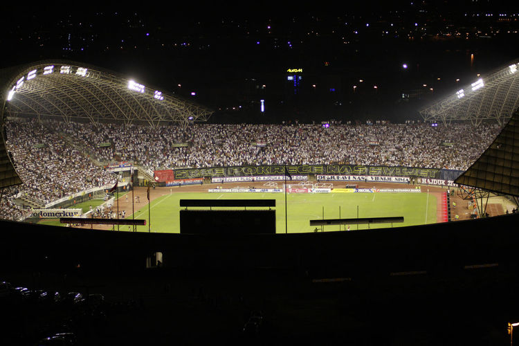 High angle view of people on soccer field at night