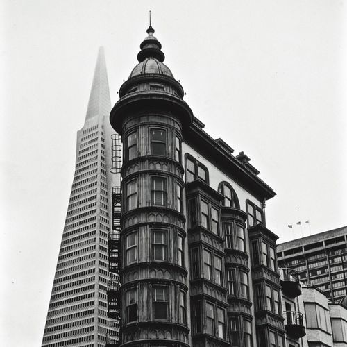 Low angle view of columbus tower with transamerica pyramid against clear sky