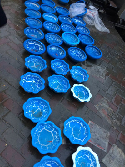 Abundance Arrangement Art And Craft Blue Business City Day Flooring Footpath For Sale High Angle View In A Row Incidental People Large Group Of Objects Market Order Outdoors Real People Retail  Street