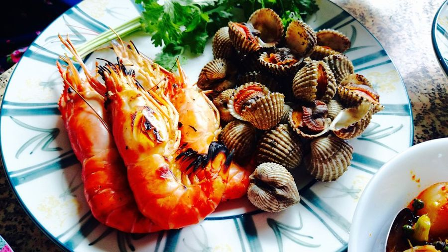 High Angle View Of Seafood Served In Plate On Table