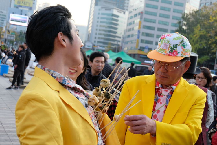Art Culture And Entertainment City Day Food Outdoors Real People Standing Yellow