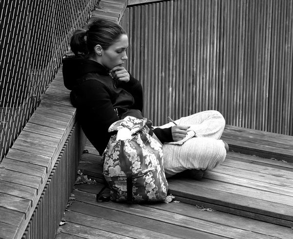 Street Photography Black And White Streetlife Decking City Photography Boardwalk Sitting Thinking Women Textures Student Monochrome Photography Snap A Stranger